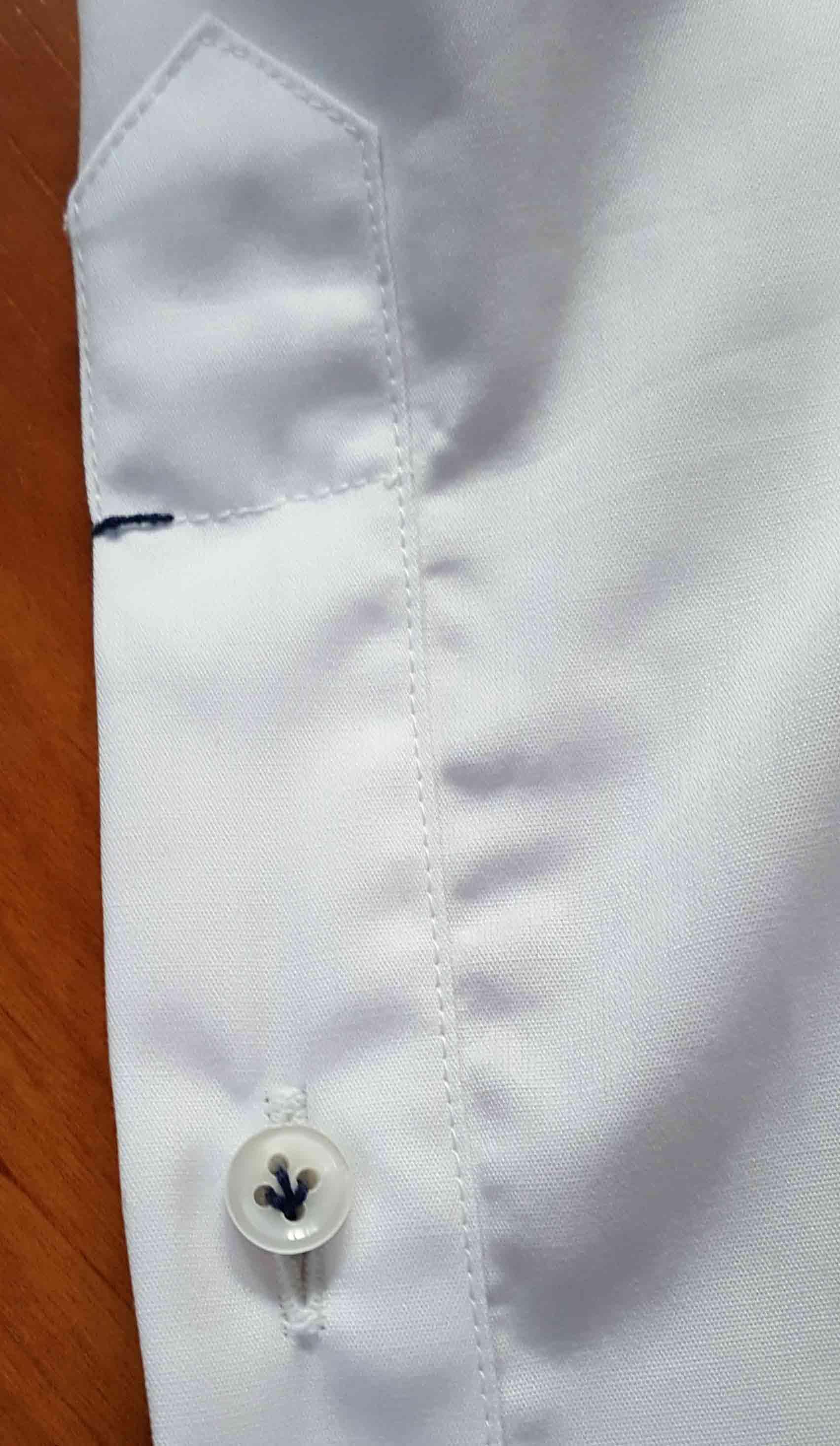 finitions mains chemise zampa